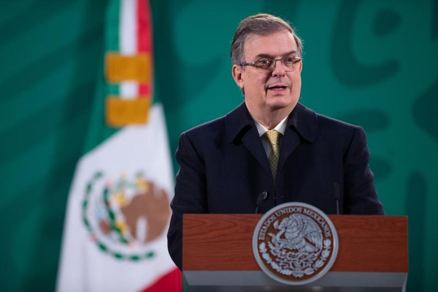 Mexico's Foreign Minister Marcelo Ebrard holds a news conference, as Mexico's government will invoke labour provisions in the new North American trade pact in a bid to ensure that illegal migrants in the United States receive coronavirus vaccines, at the National Palace in Mexico City, Mexico, January 13, 2021 – Mexico's Presidency/Handout via Reuters