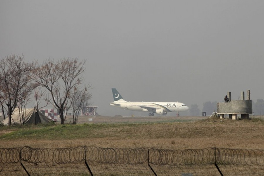 A Pakistan International Airlines (PIA) passenger plane prepares to take off from the Benazir International airport in Islamabad, Pakistan, February 9, 2016. Reuters