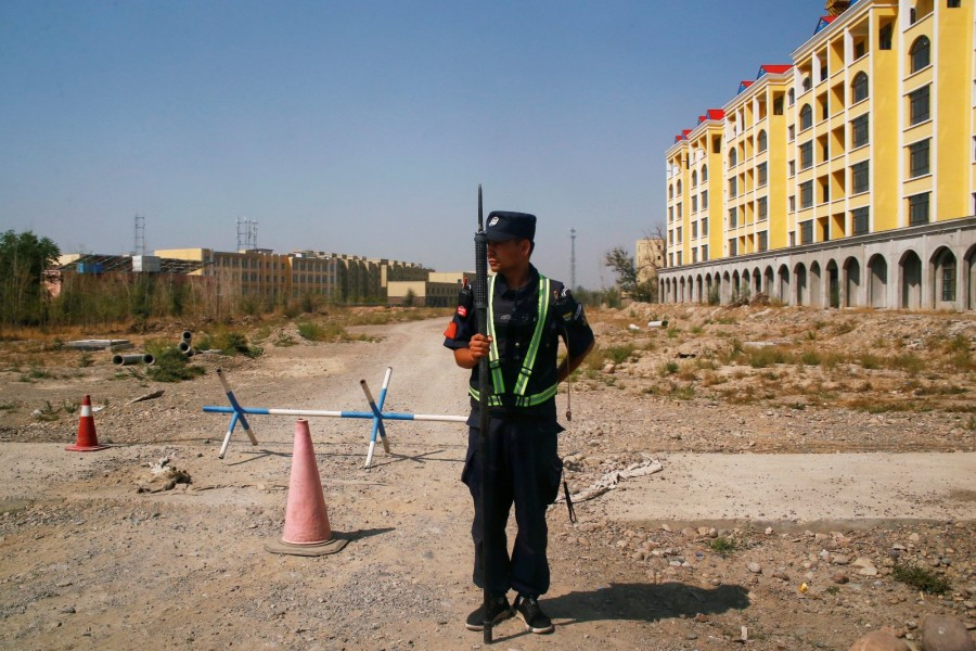 A Chinese police officer takes his position by the road near what is officially called a vocational education center in Yining in Xinjiang Uighur Autonomous Region, China, September 4, 2018. REUTERS