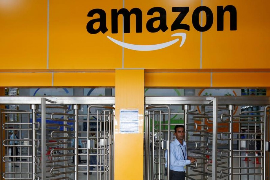 An employee of Amazon walks through a turnstile gate inside an Amazon Fulfillment Centre (BLR7) on the outskirts of Bengaluru, India on September 18, 2018 — Reuters/Files