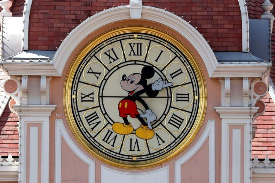 Disney character Mickey Mouse is seen on a clock at the entrance of Disneyland Paris, in Marne-la-Vallee, near Paris, as the theme park prepares to reopen its doors to the public following the coronavirus disease (Covid-19) outbreak in France on July 9, 2020 — Reuters/Files