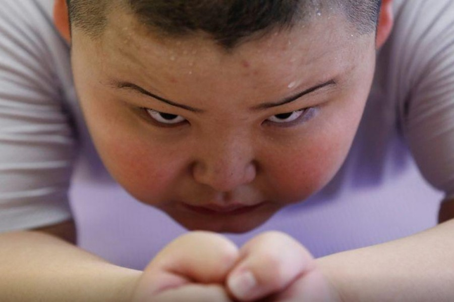Kyuta Kumagai, 10, does a plank during a one-on-one training session which his father organized at the Buddhist temple Joshin-ji in Tokyo, Japan on September 2, 2020 — Reuters/Files