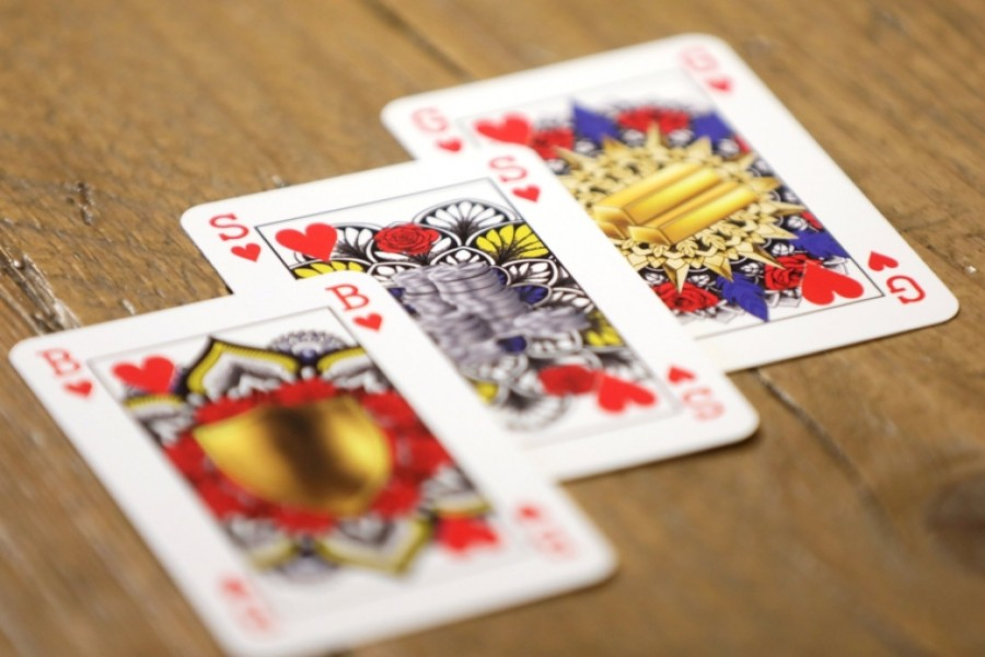 King toppled from throne of card