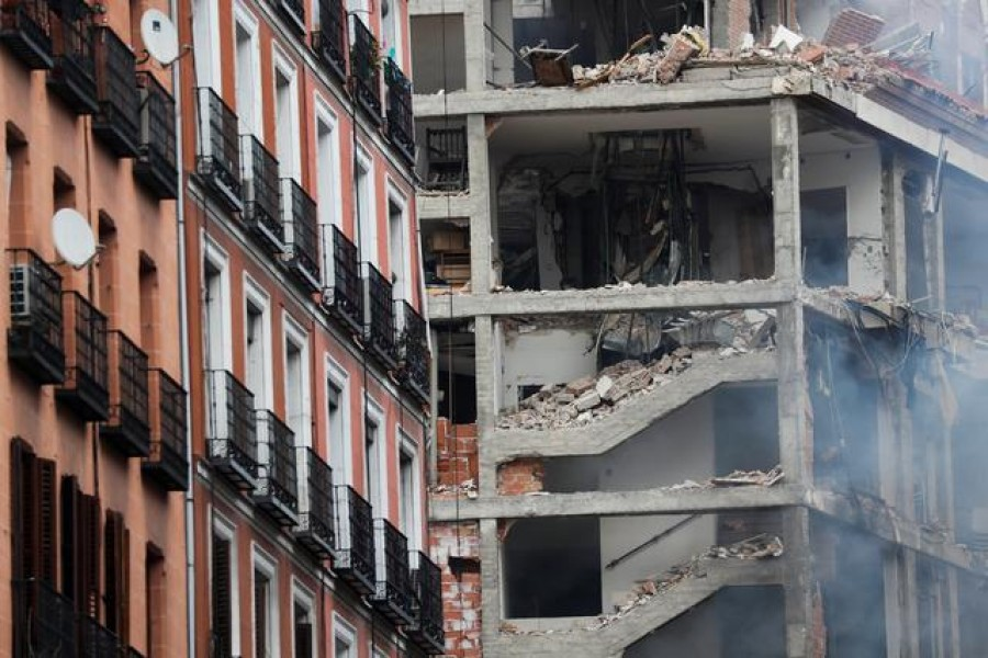 At least two dead, several injured after blast brings down building in central Madrid