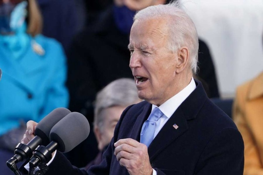 Biden tells divided nation 'democracy has prevailed' after assuming US presidency