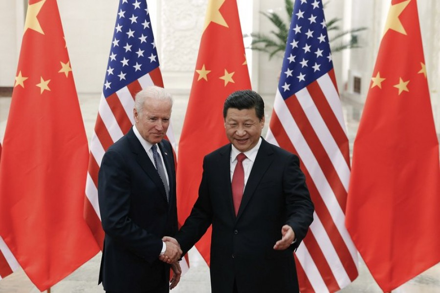 In this Dec 04, 2013, file photo, Chinese President Xi Jinping, right, shakes hands with then US Vice President Joe Biden as they pose for photos at the Great Hall of the People in Beijing — AP