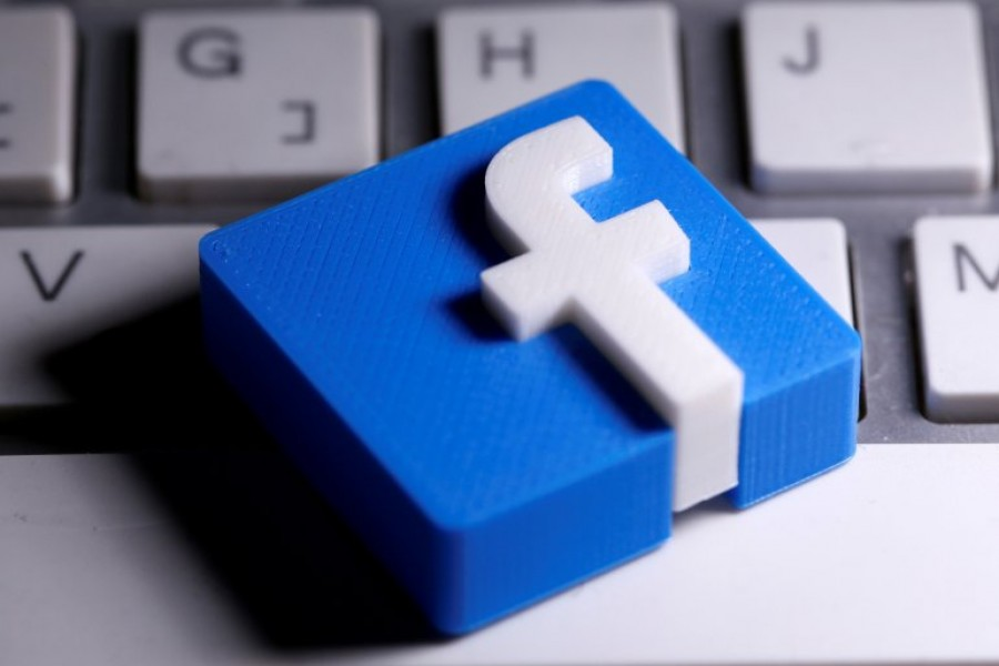 A 3D-printed Facebook logo is seen placed on a keyboard in this illustration taken March 25, 2020 — Reuters/Files