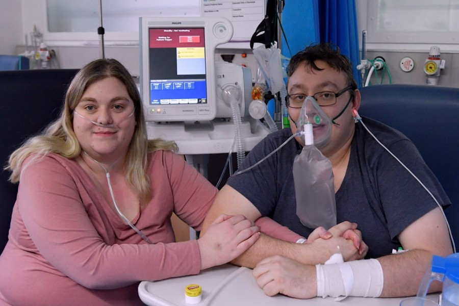 Lizzie Kerr, 31, and Simon O'Brien, 36, embrace in a Covid-19 ward, days after they married in an ICU (Intensive Care Unit) when both had become critically ill with the coronavirus disease (Covid-19), and were uncertain of their chances of surviving, in Milton Keynes University Hospital, Milton Keynes, Britain, January 20, 2021 — Reuters