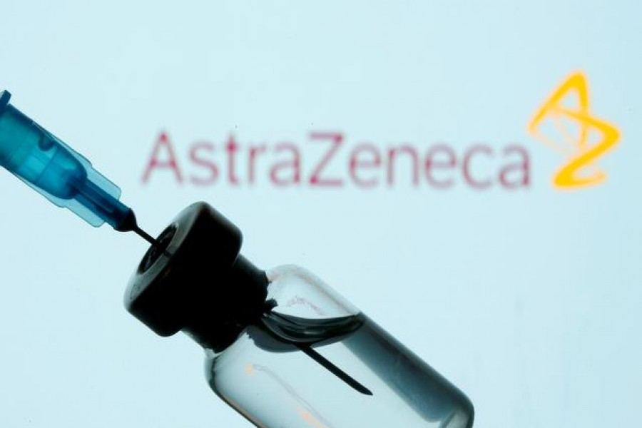 A vial and syringe in front of an AstraZeneca logo in this illustration taken January 11, 2021 — Reuters/Files