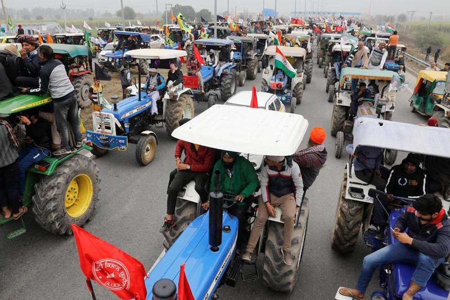 Farmers participate in a tractor rally to protest against the newly passed farm bills, on a highway on the outskirts of New Delhi, India on January 7, 2021 — Reuters/Files
