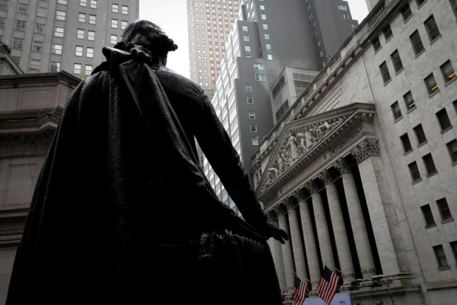 A statue of George Washington stands as Federal Hall across Wall Street from the New York Stock Exchange in Manhattan in New York City, New York, US on October 26, 2020 — Reuters/Files