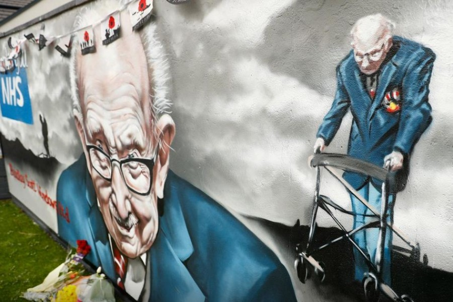 A mural of late record-breaking centenarian Captain Tom Moore, who died on Tuesday, is pictured in Two Gates, Tamworth, Britain February 3, 2021. REUTERS/Jason Cairnduff
