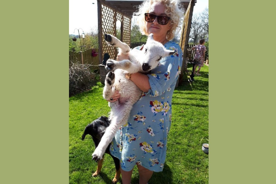 Bev Francis-Green holds a lamb in Carlisle, Britain in April, 2020. Bev Francis-Green/Handout via REUTERS