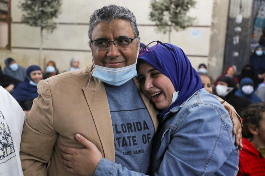 Journalist Mahmoud Hussein embraces with his daughter after being released by Egyptian authorities after four years in detention on accusations of publishing false news, in Abou Al Nomros, in Giza, Egypt on February 6, 2021 — Reuters photo