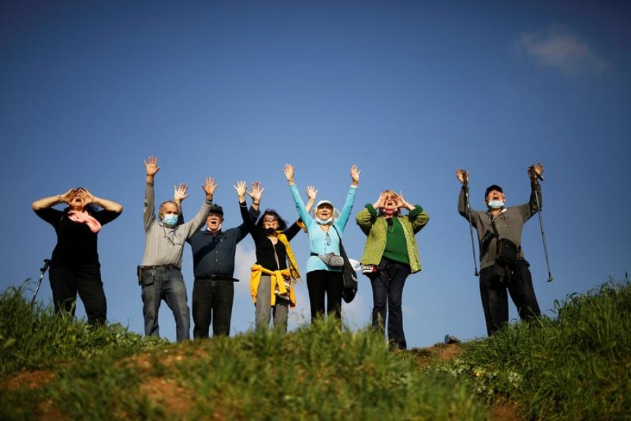 People take part in a screaming session as they seek emotional release from coronavirus disease (COVID-19) confinements, in an open area near Ra'anana, Israel