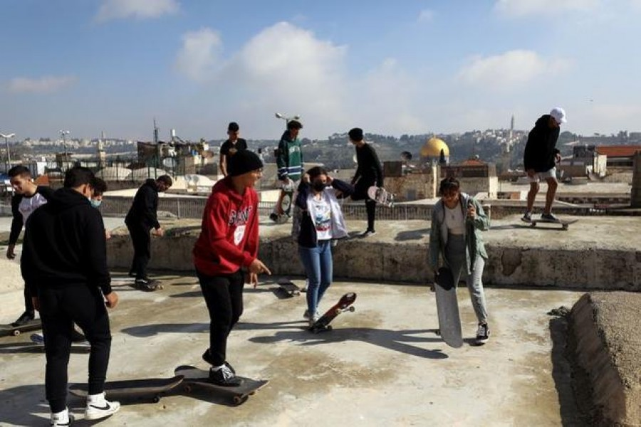 High above Jerusalem's crowds, skating the Old City rooftops