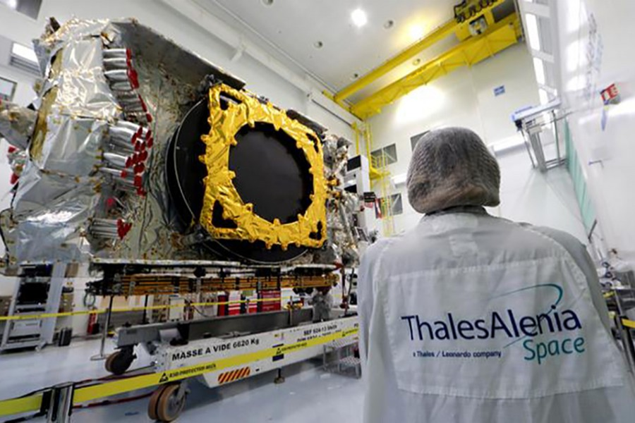 A technician stands next to the all-electric Konnect communications satellite, which will be shipped to the Guiana Space Center in Kourou, in the clean room facilities at the Thales Alenia Space plant in Cannes, France on November 22, 2019 — Reuters/Files