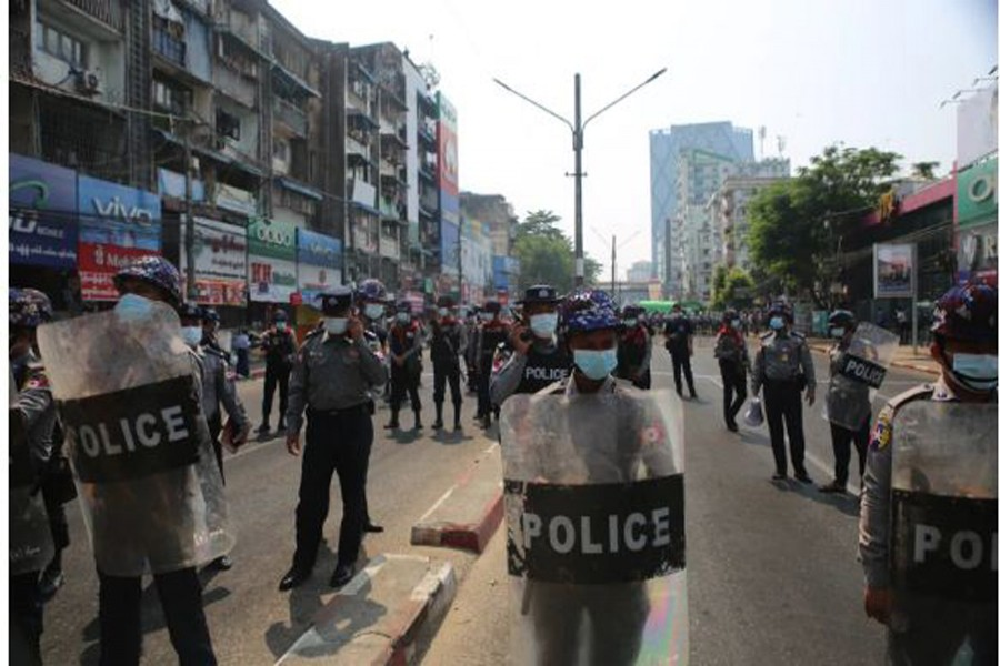 Police on streets of Yangon as thousands of people turned out at the weekend in opposition to the military coup [Andrew Nachemson/Al Jazeera]