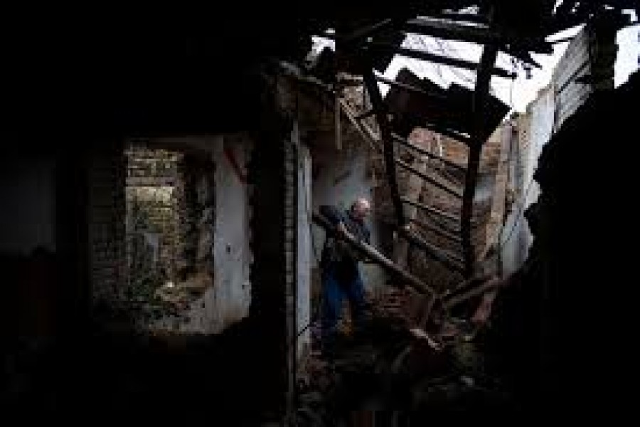 """Zoltan Berki Sr, 55, searches for firewood in an old abandoned house in Ozd, Hungary, December 19, 2020. To Zoltan Berki Sr pollution means chest pain and coughs, but cold is a more imminent danger. """"We collect what we find and take it home to burn,"""" Berki said. """"They heat up nicely, and we can't afford to buy anything."""" — Reuters/Files"""