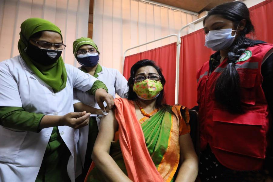 A woman receives the Covid-19 vaccine in Dhaka on February 7. —Xinhua Photo