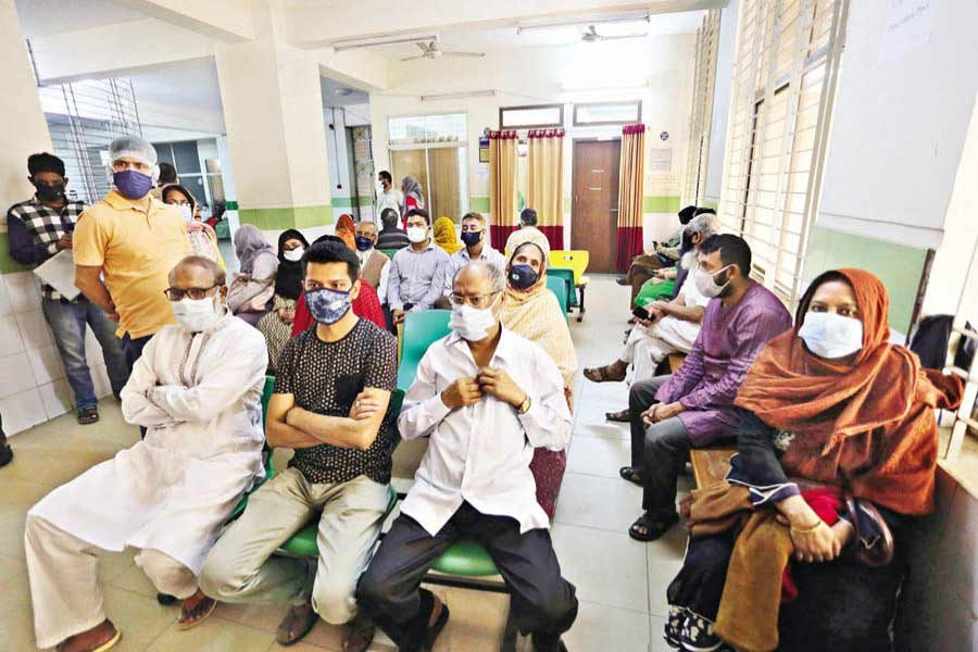 People wait at the city's Mugda Medical College and Hospital on Saturday for taking Covid-19 vaccines as the government's inoculation drive continues across the country — FE photo by KAZ Sumon