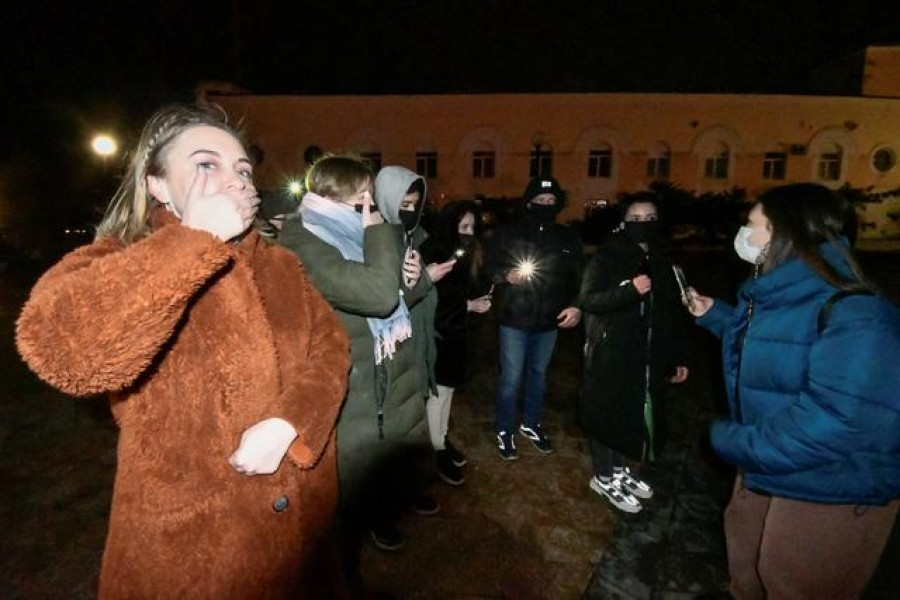 Supporters of Russian opposition politician Alexei Navalny, who was recently jailed for parole violations, use flashlights during a protest demonstration in Vladivostok, Russia February 14, 2021. REUTERS/Yuri Maltsev