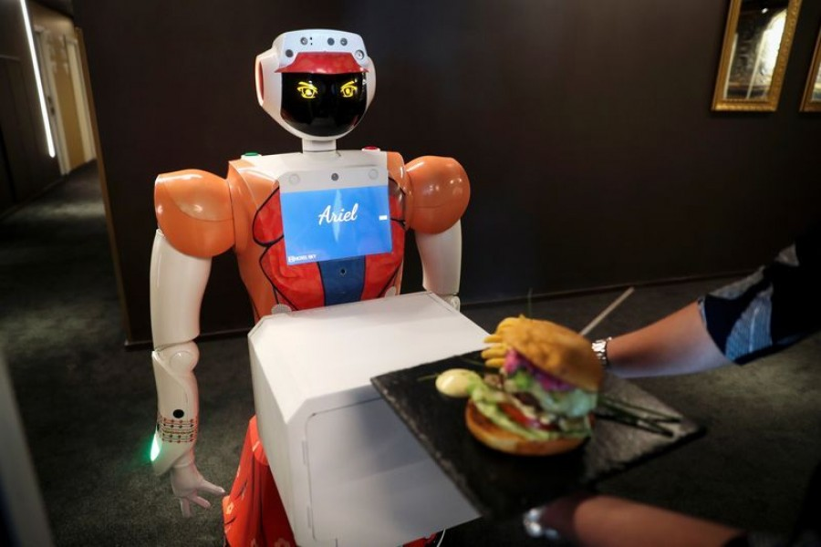 AI-powered robot Ariel delivers room service to a guest at the Hotel Sky, the first in Africa to use automated attendants, in Johannesburg on South Africa on February 9, 2021 — Reuters photo