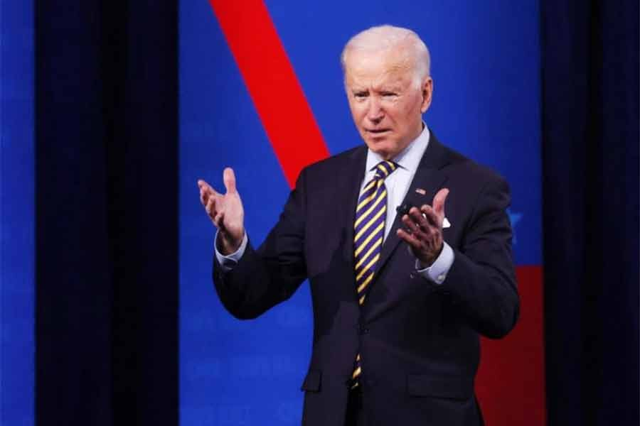 China will pay a price for its human rights abuses, Biden warns