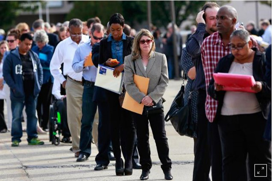 FILE PHOTO: People wait in line to enter the Nassau County Mega Job Fair at Nassau Veterans Memorial Coliseum in Uniondale, New York October 07, 2014. US job openings rose to their highest level in more than 13 years in August even as hiring fell, the US Department of Labor said. REUTERS/Shannon Stapleton/File Photo