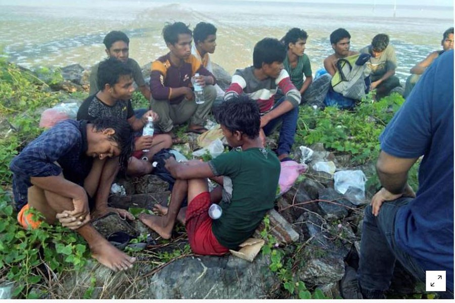 FILE PHOTO: Dozens of people, believed to be Rohingya Muslims from Myanmar who were dropped off from a boat are pictured on a beach near Sungai Belati, Perlis, Malaysia in this undated handout photo released April 08, 2019. Royal Malaysian Police/Handout via REUTERS