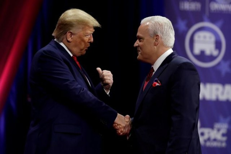 Former US President Donald Trump (L) shakes hands with Matt Schlapp, chairman of the American Conservative Union, at the Conservative Political Action Conference (CPAC) annual meeting at National Harbor in Oxon Hill, Maryland, US, February 29, 2020. REUTERS/Yuri Gripas/File Photo