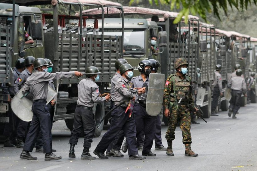 Police and soldiers are seen during a protests against the military coup, in Mandalay, Myanmar, February 20, 2021. REUTERS/Stringer