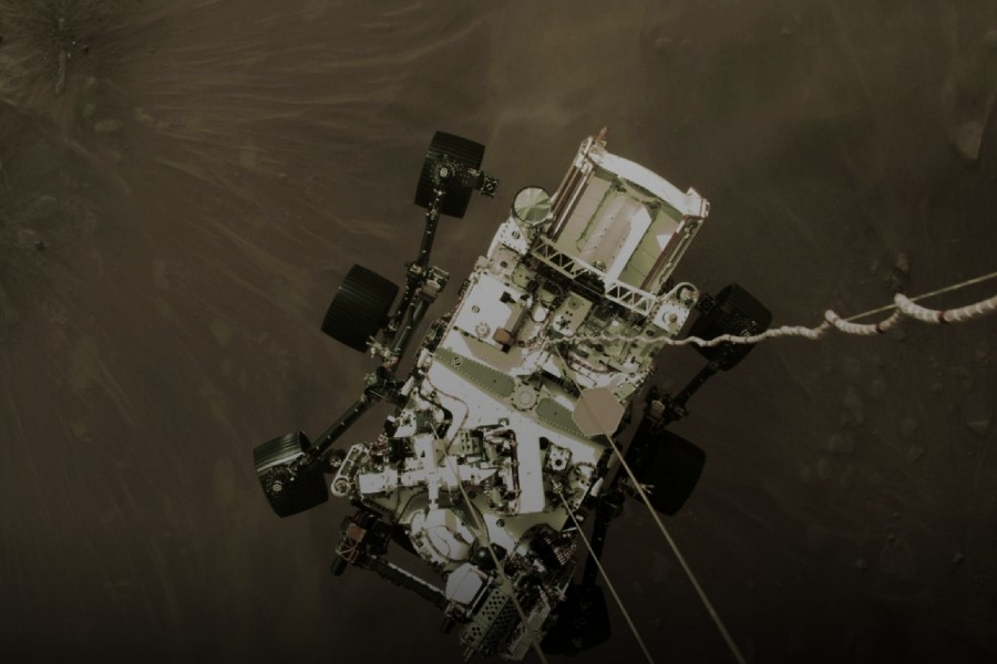 NASA's Perseverance rover descends to touch down on Mars in a still image from a video camera aboard the descent stage taken February 18, 2021. NASA/JPL-Caltech/Handout via REUTERS