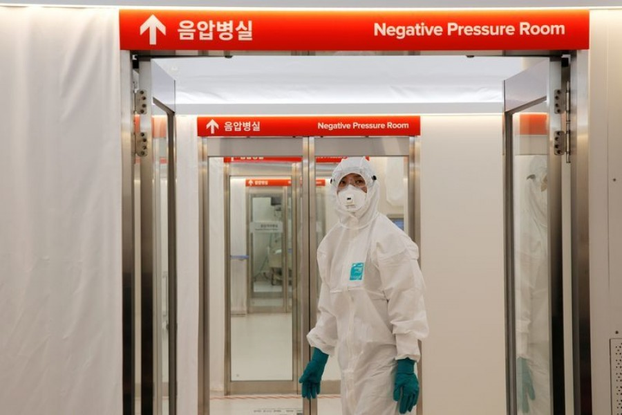 FILE PHOTO: A medical worker checks the doors inside the Mobile Clinic Module outside Korea Cancer Center Hospital in Seoul, South Korea, January 8, 2021. REUTERS/Heo Ran
