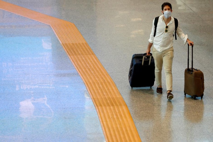 A passenger wearing a protective face mask walks at Fiumicino Airport in Rome, Italy on May 28, 2020 — Reuters/Files