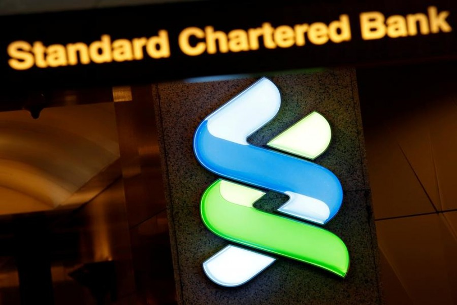 A logo of Standard Chartered is displayed at its main branch in Hong Kong, China on August 1, 2017 — Reuters/Files