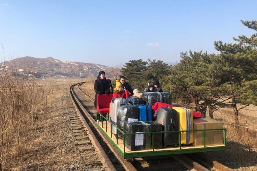 image captionThe group of Russian diplomats, which included children, pushed themselves for more than 1km over train tracks - Photo courtesy: Russian Foreign Ministry/Facebook