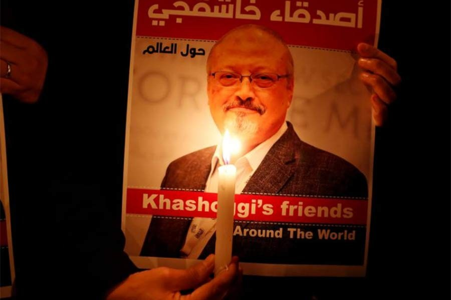 A demonstrator holds a poster with a picture of Saudi journalist Jamal Khashoggi outside the Saudi Arabia consulate in Istanbul in 2018 -Reuters file photo