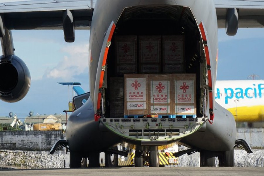 In this photo provided by the Presidential Communications Operations Office-Office of the Global Media Public Affairs, a Chinese military plane carrying the first batch of Sinovac vaccine from China arrives at the Villamor Air Base in Manila, Philippines on Sunday Feb. 28, 2021.  (PCOO-OGMPA via AP)