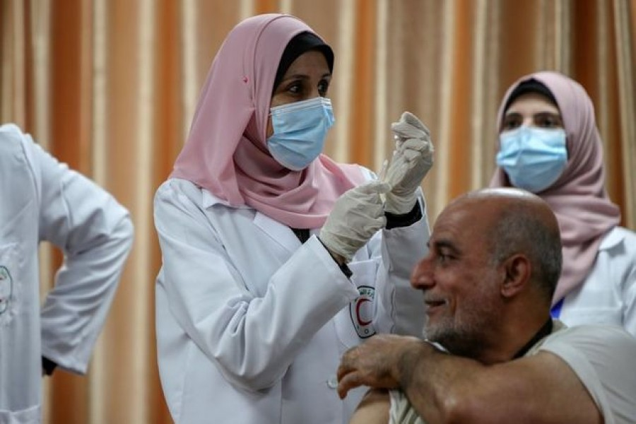 A health worker prepares to vaccinate former Palestinian health minister Jawad Tibi against the coronavirus disease (Covid-19) vaccine in Gaza City, February 22, 2021 — Reuters/Files