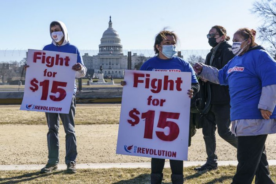 Activists appeal for a $15 minimum wage near the Capitol in Washington, Thursday, Feb. 25, 2021. (AP)