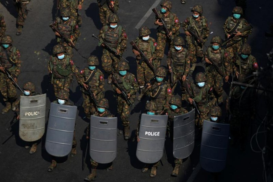 FILE PHOTO: Myanmar soldiers from the 77th light infantry division walk along a street during a protest against the military coup in Yangon, Myanmar, February 28, 2021. REUTERS/Stringer