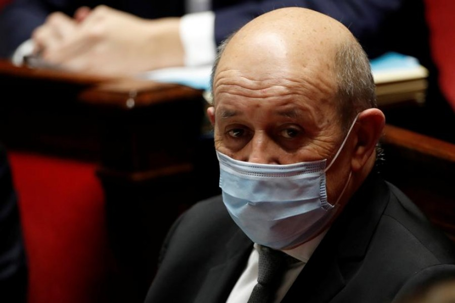 FILE PHOTO: French Foreign Minister Jean Yves Le Drian, wearing a protective face mask, attends the questions to the government session at the National Assembly in Paris amid the coronavirus disease (COVID-19) outbreak in France, January 26, 2021. REUTERS/Gonzalo Fuentes