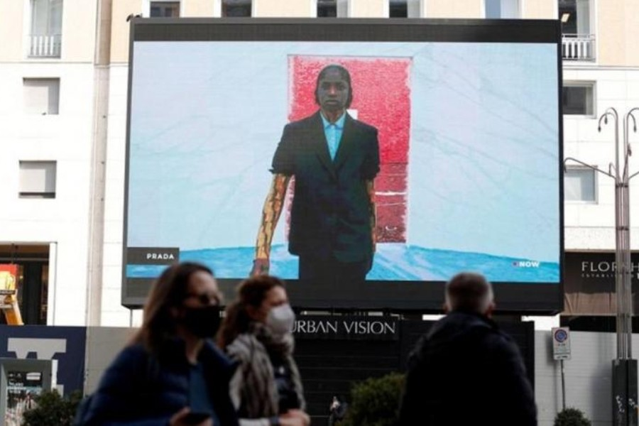 A giant screen set up in San Babila square streams the Prada Fall/Winter 2021/2022 digital show during Fashion Week in Milan, Italy, February 25, 2021. (Reuters)