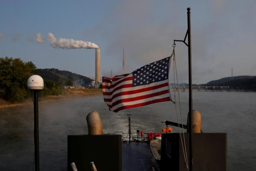 The US flag flies on a towboat as it passes the W H Sammis Power Plant, a coal-fired power-plant owned by FirstEnergy, along the Ohio River in Stratton, Ohio, US, September 10, 2017 — Reuters/Files