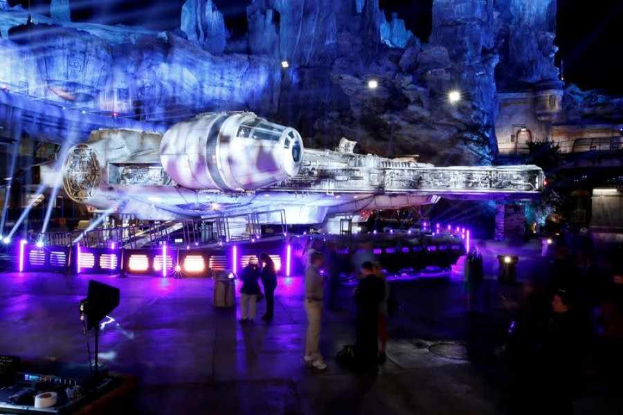"Guests explore ""Star Wars: Galaxy's Edge"" near a Millennium Falcon starship at Disneyland Park in Anaheim, California, US, May 29, 2019 — Reuters/Files"