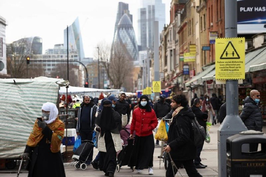 People walk past shops and market stalls, amid the coronavirus disease (Covid-19) outbreak in London, Britain, February 15, 2021 — Reuters/Files