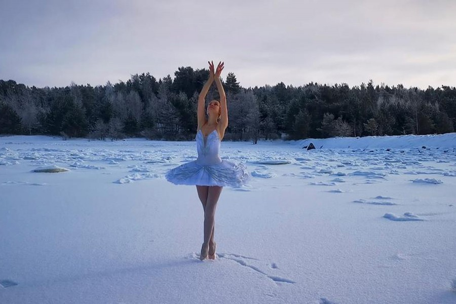 Ballet dancer from the Mariinsky Theatre Ilmira Bagautdinova performs on the ice of frozen Batareynaya Bay to protest the construction of a grain terminal and other infrastructure in the Gulf of Finland, in Leningrad region, Russia, in this still image taken from video released on February 20, 2021 — Ilmira Bagautdinova/Reuters TV via REUTERS