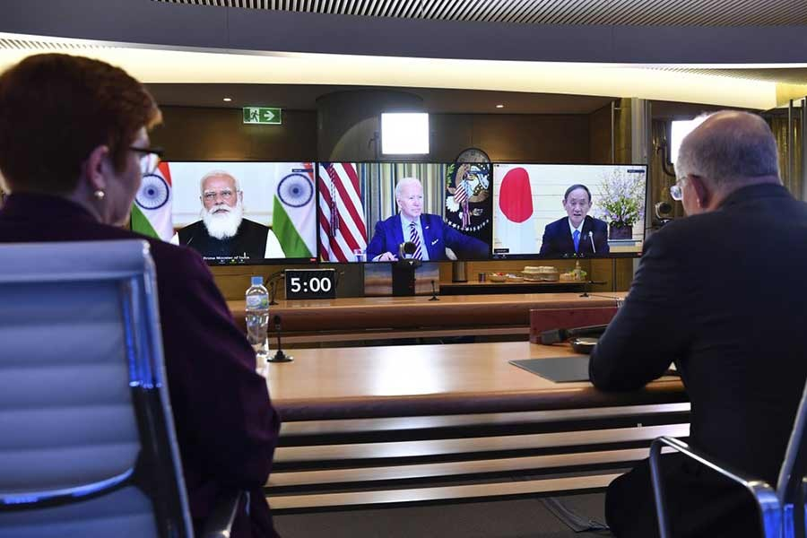 Australia's Prime Minister Scott Morrison, right, and Minister for Foreign Affairs Marise Payne, left, participate in the inaugural Quad leaders meeting with US President Joe Biden, the Japan's Prime Minister Yoshihide Suga and India's Prime Minister of India Narendra Modi in a virtual meeting  on Saturday -AP Photo