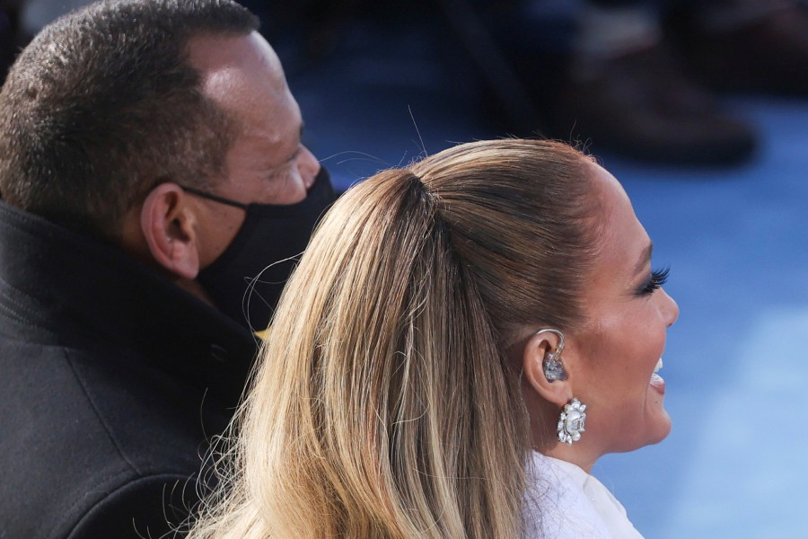 Singer Jennifer Lopez smiles next to Alex Rodriguez during the inauguration of Joe Biden as the 46th President of the United States on the West Front of the U.S. Capitol in Washington, U.S., January 20, 2021. REUTERS/Jonathan Ernst/Pool